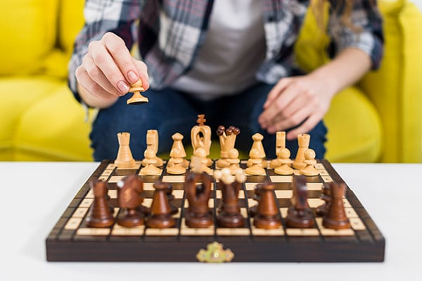 closeup of person play solo chess